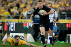 New Zealand All Blacks 2nd-five Ryan Crotty on his way to scoring against Australia, during the Rugby Championship 1st Bledisloe test match. Photo / Brett Phibbs.