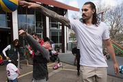 Steven Adams teaches a Kiwi kid about rim protection while in New Zealand. Photo / Brett Phibbs