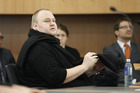 Kim Dotcom appearing in Auckland District Court for the decision on his extradition. Photo / Nick Reed