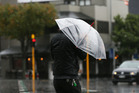 Aucklanders have the umbrellas out. Photo / File