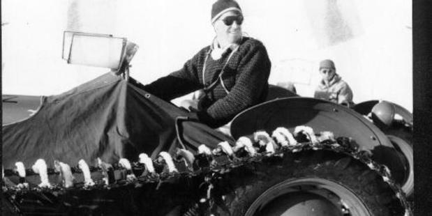 Sir Edmund Hillary at the wheel of a snow tractor . Used Weekly News 6 Feb 1957. Credit : Trans-Antarctic Expedition