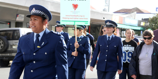 Marching through Kaitaia to mark 75 years of women in the police. Photo / Northern Advocate