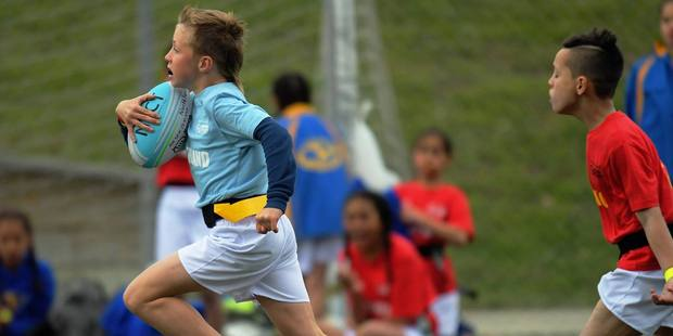Kamo Primary School's Jacob Lowther makes a dash past the defence in the team's game against Canterbury.