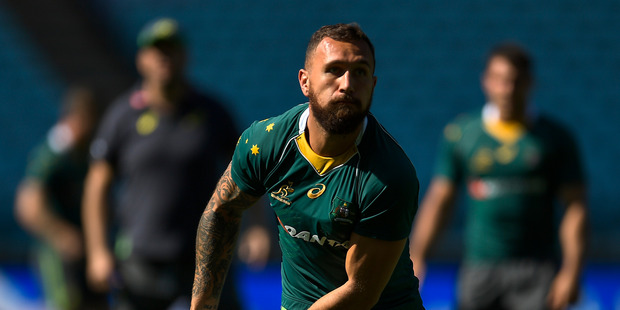 Loading Quade Cooper looks to pass the ball during an Australian Wallabies captain's run at ANZ Stadium on August 19, 2016 in Sydney, Australia. Photo / Getty Images.