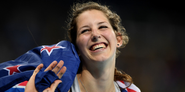 Loading Eliza McCartney celebrates winning bronze in the women's pole vault. Photo / AP