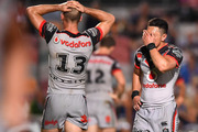 Nathaniel Roache (r) and Simon Mannering of the Warriors react after conceding a drop out during the round 24 NRL loss. Photo / Getty Images.