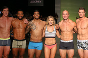 AUCKLAND, NEW ZEALAND - AUGUST 25: All Black Sevens players Sam Dixon (L) Lote Raikabula, Regan Ware, The Bachelor winner Matilda Rice (C) DJ Forbes and Scott Curry (R) showcase designs by Jockey on