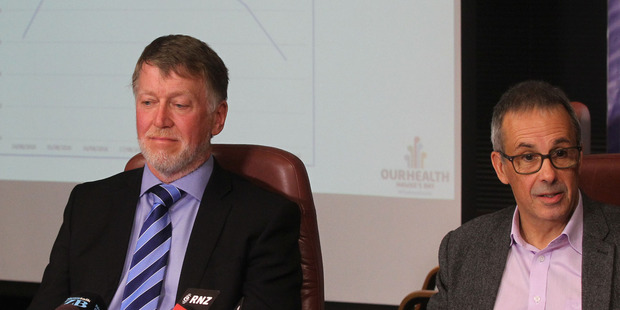 QUESTIONS: DHB chief executive Dr Kevin Snee (left) and Dr William Ranger, acting medical officer of health, address media this morning following last week's gastro outbreak. PHOTO DUNCAN BROWN