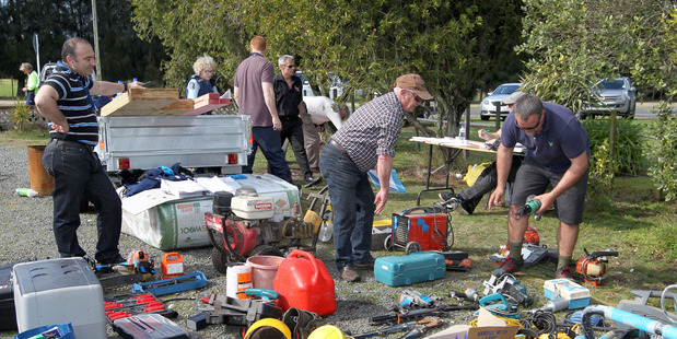 Loading Builders and tradesmen were amongst those who recoverered their gear from a huge stash of stolen goods discoverered by police at Ngatarawa Rd. Photo Duncan Brown