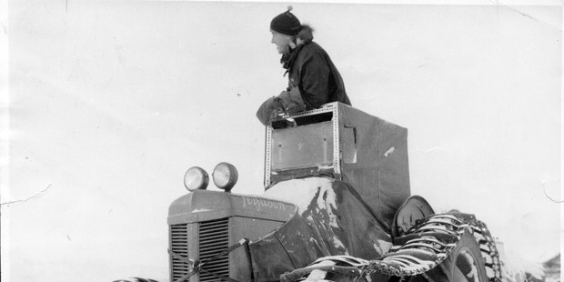 Sir Edmund Hillary leads his tractor train out from Scott Base at the start of a journey to the South Pole. Photo / Trans-Antarctic Expedition