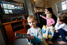 The broadband usage in the Kemp household has gone from 50GB per month to 200GB, all because of Netflix and YouTube. Liam (front) with mum Candice and sisters Danielle and Olivia debate what to watch on the streaming service. Photo / John Stone