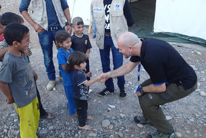 Dennis Mundy meets Syrian refugee children at a camp in Lebanon. Photo/supplied