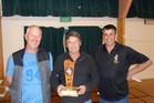 Alan Bell (middle) presents Clayton Jones and Mate Radich with the Kerry Manson Memorial trophy last Thursday.
