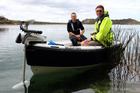 Environmental monitoring officers Scott Lyon, left, and Andrew Macdonald put the Mudfish through its paces on the Kai Iwi Lakes recently. Mr Macdonald is holding the remote control used to steer the vessel's bow-mounted electric motor.
