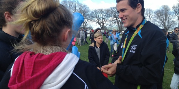 Sam Webster chats with fans at the Cambridge welcome home for Rio Olympians. Photo / Natalie Akoorie.