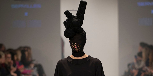 A model navigates the runway with clusters of knotty nuggets balanced on her head. Photo / Getty