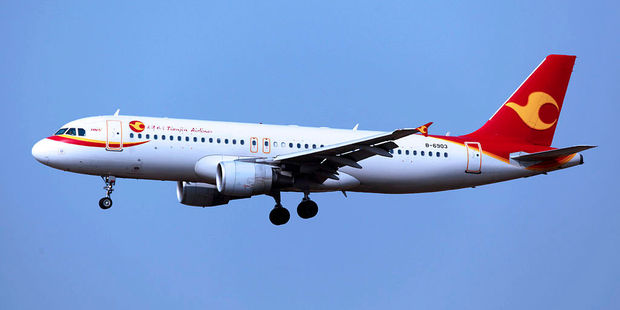 A Tianjin Airlines A320 aircraft. The airline will fly larger A330 jets between Tianjin, Chongquing and NZ three times a week from December. Photo / byeangel from Tsingtao. Creative Commons.
