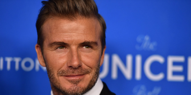 The homeless man spent several years as David Beckham's bodyguard, ensuring the security of his wife, Victoria, and their three boys. Photo / AP