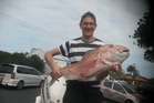 Simon Mackereth wasn't expecting a solid 8.2kg snapper on his strayline. Picture / Phil Coveny