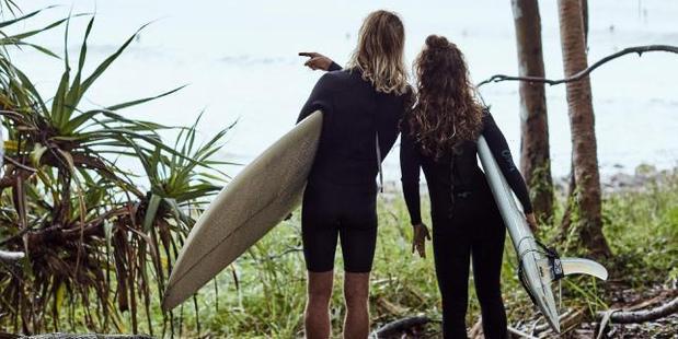 Surfers at Noosa. Photo / Jenny Hewett