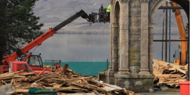 What was to be a Sea of Galilee fishing village and harbour at Falstone Camp is demolished by Paul Smith Earthmoving employees at Lake Benmore. Photo / Hamish MacLean, Otago Daily Times