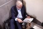 Jeremy Corbyn sitting on the floor of a train, as seen in a Guardian video.