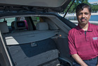 Carnegie Mellon University Professor Raj Rajkumar, shown in 2014 with the main control center of a self-driven car, said he is more convinced than ever that gradually introducing safe-driving features