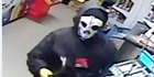 MASKED RAIDER: Security surveillance footage from Napier's Te Awa Dairy yesterday, before two robbers were forced to flee empty-handed after a storekeeper retaliated. PHOTO/SUPPLIED
