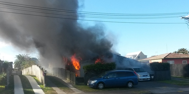 A house fire on Dickson Rd, Papamoa. Photo/James Smith