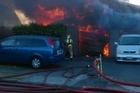 A fire rips through a house on Dickson Rd, Papamoa. Video/James Smith