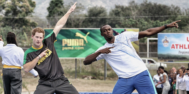 Prince Harry joked around with champion sprinter Usain Bolt during a previous trip to Jamaica, and now the pair are organising a new race challenge. Photo / Getty