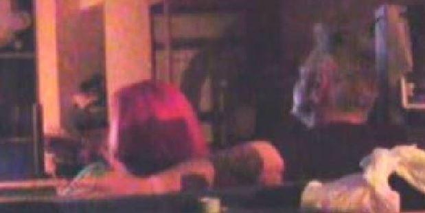 A man puts his arm around Imogen. Photo / YouTube