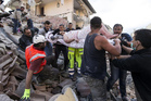 Rescue workers are scrambling to save people from the rubble following the devastating earthquake in Italy.