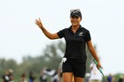 Lydia Ko celebrates after sinking a birdie putt on the 18th hole to secure an Olympic silver medal. Photo / Getty