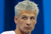 An American report has claimed Rio police exaggerated the truth in their version of the messy Ryan Lochte scandal. Photo / AP