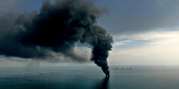 Smoke billows from controlled oil burns near the BP Deepwater Horizon oil spill. Photo / Derick E. Hingle