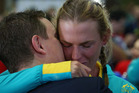 An athlete is embraced during the Welcome Home for Australian Olympic Games athletes at Sydney International Airport. photo / Getty