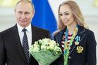 Russian President Vladimir Putin, left, poses with Russia's Olympic rhythmic gymnastics champion Anastasia Maximova. Photo / AP
