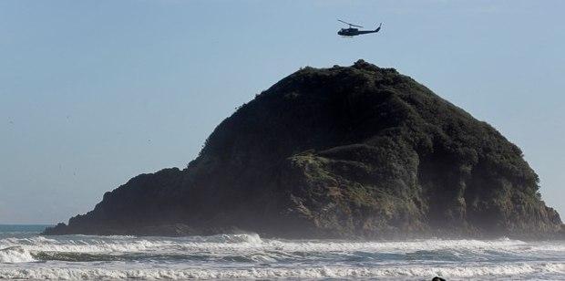 A teenager went missing when his boat capsized near Paritutu rock in Taranaki. File photo