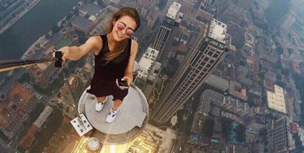 These astonishing photos of Russian 23-year-old Angelina Nikolau's sky-high catwalk show have turned her into a social media sensation. Photo / Angela Nikolau Instagram
