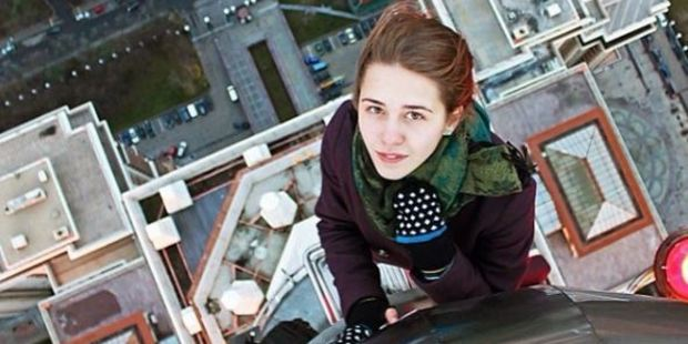But it's not just selfies, she also has fellow skyscraper-wandering friends photograph her clambering up tall buildings. Photo / Angela Nikolau Instagram