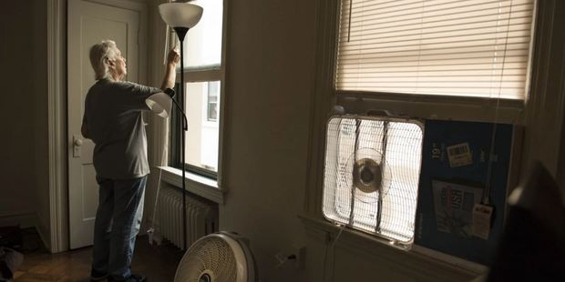 Witter draws the blinds at her new apartment in Southeast Washington. Photo / The Washington Post