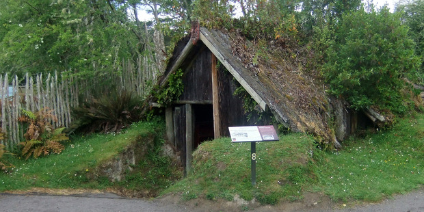 A whare at Te Wairoa that was partially buried during the volcanic eruption of Mt Tarawera in 1886. Photo / Creative Commons image by Flickr user Gwydion M Williams