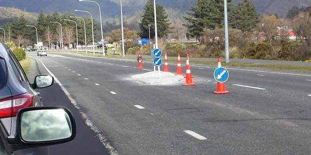 This newly installed traffic island on a busy Lower Hutt street has angered residents who says it's a road hazard which forces them to drive in the cycle lane. Photo/ Facebook