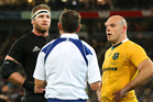 Referee Romain Poite speaks to both teams captains, Kieran Read (left) and Stephen Moore, during the second Bledisloe Cup test last night in Wellington. Photo / Photosport