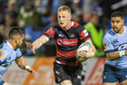 Canterbury's Johnny McNicholl looks to fend against Northland. Photo / Photosport