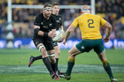 All Blacks captain Kieran Read taking on his Wallabies opposite Stephen Moore. Photo / Mark Mitchell