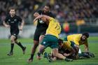 All Blacks prop Charlie Faumuina smashes into Wallabies prop James Slipper. Photo / Mark Mitchell