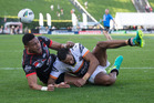 Warriors player David Fusitu'a is beaten to the ball by Joshua Addo-Carr. Photo / Dean Purcell