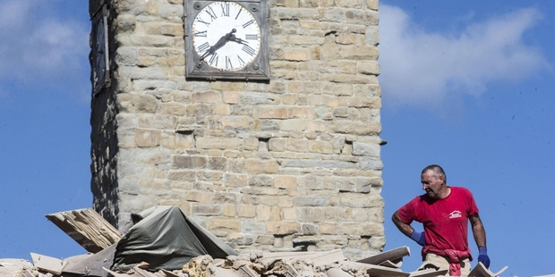 A clock in Amatrice, frozen at the time of the earthquake. Photo / AP